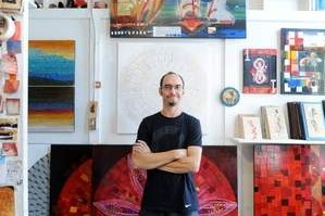 Artist Stephen Lange, who supports the changes at the Wedge, at his Wedge Building studio. AC-T photo by Erin Brethauer.