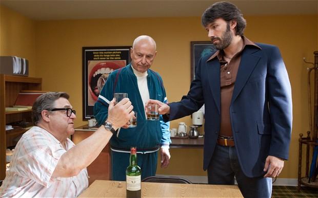 John Goodman, Alan Arkin, and Ben Affleck give thanks in Argo. (Warner Bros. Pictures)