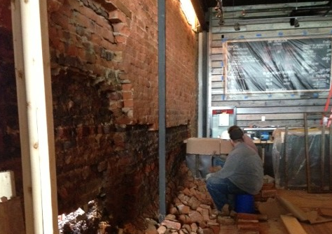Building wall repaired at new Farm Burger restaurant after damage