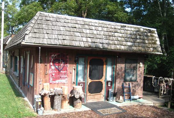 Asheville artist Rob Seven puts his funky Candler creekside studio up for sale