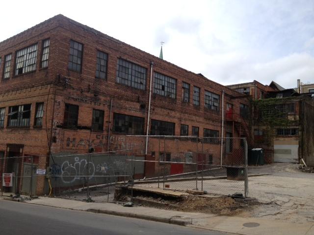 Demolition begins on downtown Asheville building between Church St., S. Lex