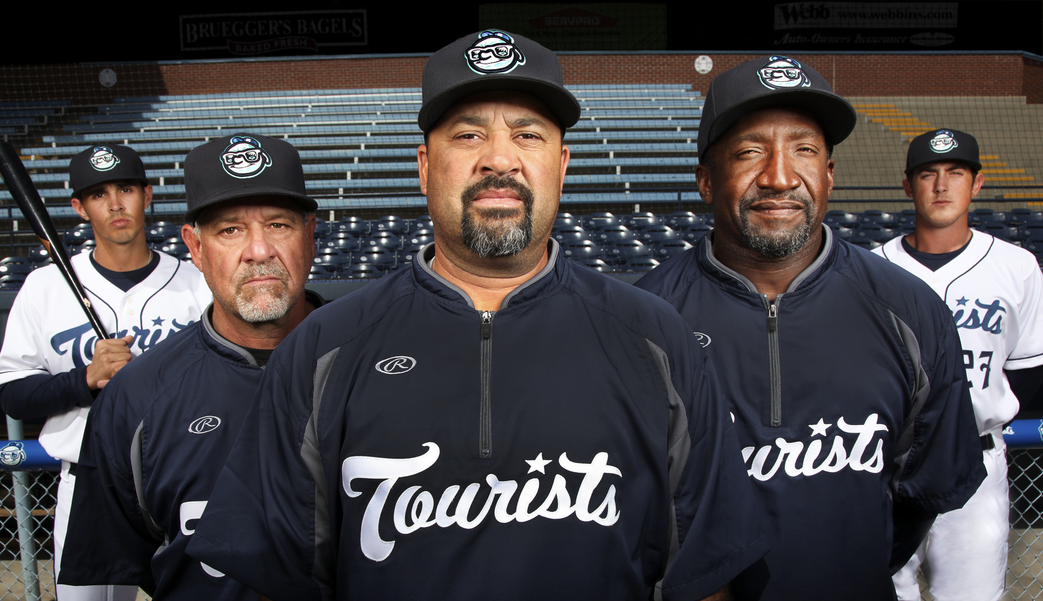 The Asheville Tourists will open their 2014 season on Thursday at McCormick Field. Pictured, from left: infielder Alec Mehrten; pitching coach Mark Brewer;  manager Fred Ocasio; hitting coach Mike Devereaux; and pitcher Zach Jemiolia. /Photo by Stewart O'Shields