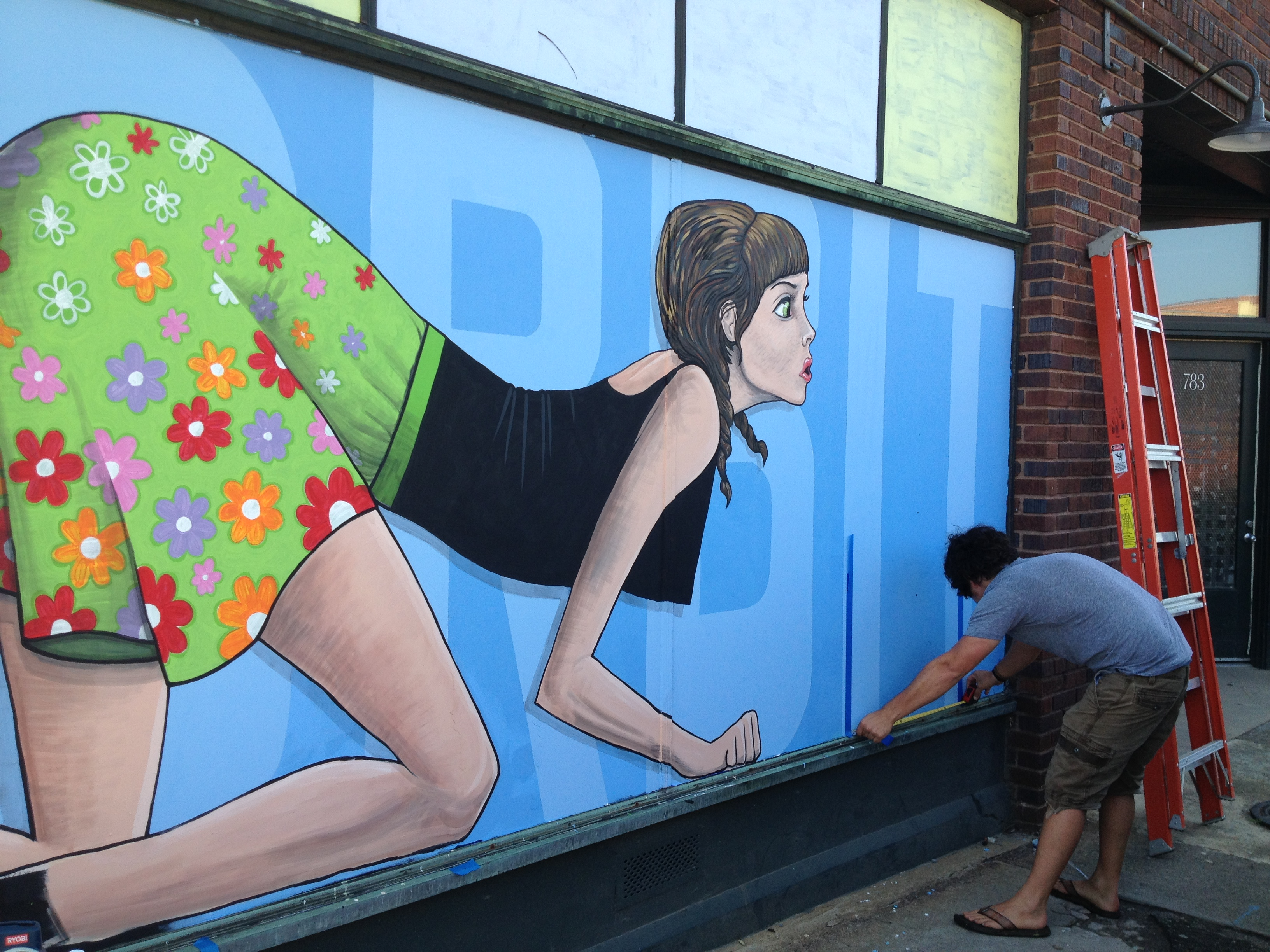 West Asheville residents debate artistic merit of new mural on Orbit DVD