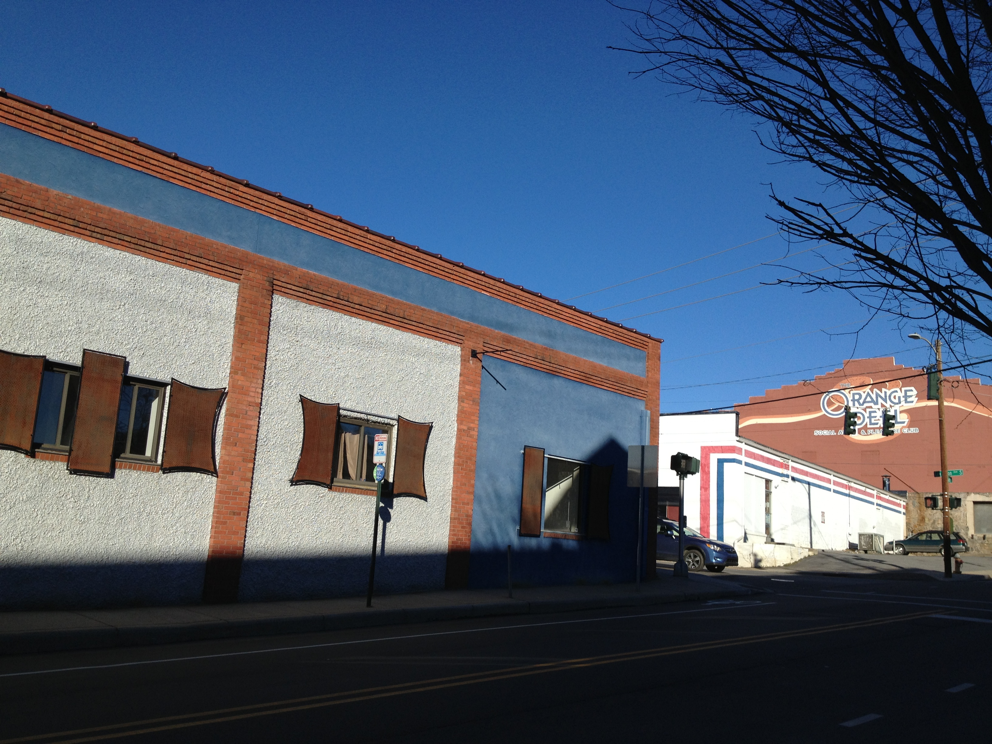 HiveMind Brew House is planned for this building on the left at the corner of South Lexington and Hilliard avenues. The building is the former site of Asheville Music School. It's near Storm rum bar and restaurant, the Orange Peel music venue and Wicked Weed Brewing.