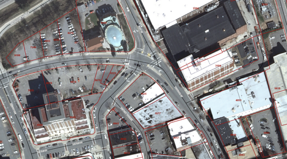 A piece of city-owned property on Haywood Street in downtown Asheville will soon be back up for sale. The property is roughly shaped like a triangle, with its top point aimed at teal circle in the center/left of this photo. The big white square at center/right is the U.S. Cellular Center.