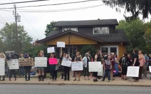 Protesters outside Waking Life Coffee shop Monday morning. Photo courtesy of Jennifer Saylor.
