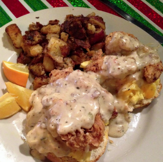 Chicken, biscuit, gravy, eggs, cheese, and hash browns a la Mojo.