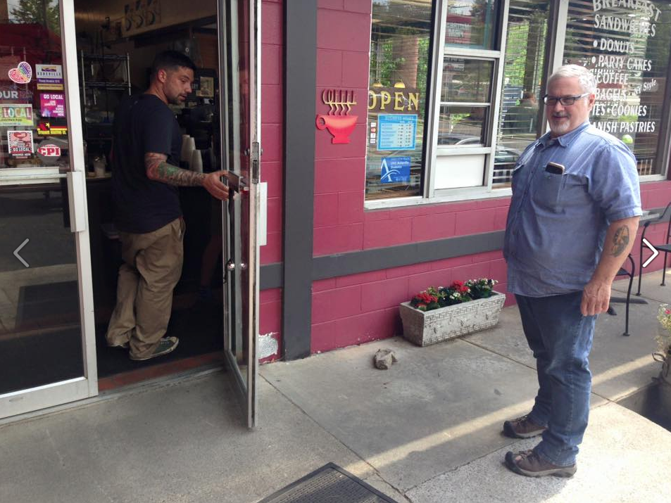 Rob holds the door for his dad, Bob.