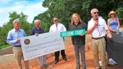 In this photo from Asheville Area Habitat for Humanity's website, musician Warren Haynes presents local Habitat officials with a check for $500,000 at the nonprofit's Hudson Hills subdivision. The money was raised through Haynes' annual Christmas Jam concert.