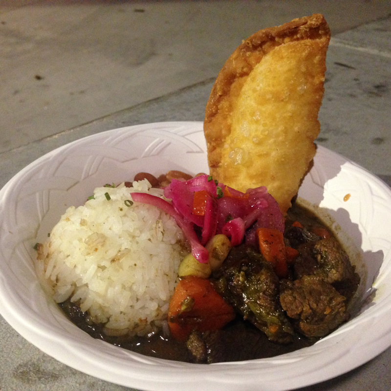 Beef stew, with rice, pickled stuff, and a cheese empanada.