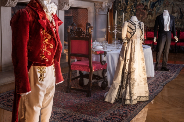 "Costumes worn by Johnny Depp and Radha Mitchell in the film ""Finding Neverland"" stand in the Banquet Hall of Biltmore House as part of ""Designed for Drama: Fashion from the Classics."" The exhibit will be on display through July 4./ Photo courtesy of Biltmore Estate"