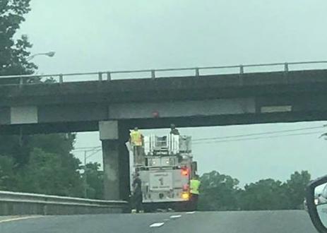 Asheville police close I-240 to remove red 'peace' button from bridge