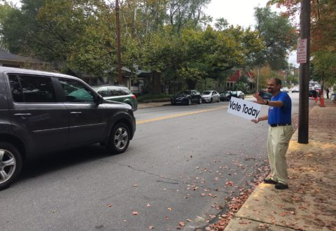 Vijay Kapoor, campaigning Tuesday in the Montford neighborhood./ photo by Jason Sandford