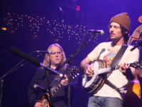 Tributes, jams and driving energy warm snowy Christmas Jam in Asheville