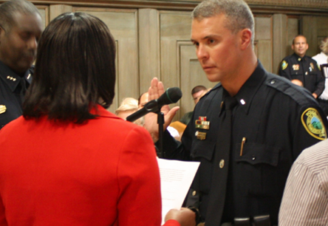 In this August 2012 photo, Asheville Police Department officer Mark Byrd accepts his promotion to captain.