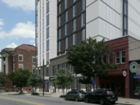 An architectural rending showing how the Create 72 Broadway building would fit among existing buildings on Broadway Street in Asheville.